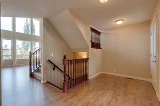 Photo 2: 144 Tuscany Meadows Heath NW in Calgary: Tuscany Detached for sale : MLS®# A1030703
