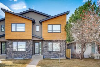 Photo 1: 1617 22 Avenue NW in Calgary: Capitol Hill Semi Detached for sale : MLS®# A1087502