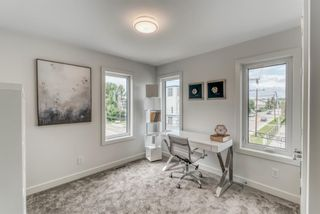Photo 30: 98 23 Street NW in Calgary: West Hillhurst Row/Townhouse for sale : MLS®# A1066637