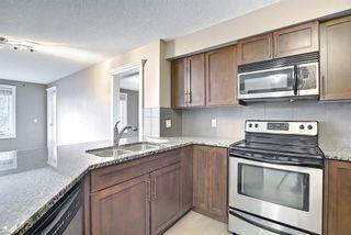 Photo 3: 108 500 Rocky Vista Gardens NW in Calgary: Rocky Ridge Apartment for sale : MLS®# A1136612