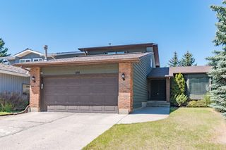 Photo 1: 884 Coach Side Crescent SW in Calgary: Coach Hill Detached for sale : MLS®# A1105957
