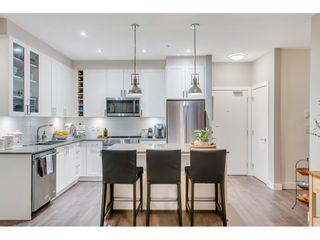 """Photo 7: 105 16380 64 Avenue in Surrey: Cloverdale BC Condo for sale in """"The Ridgse and Bose Farms"""" (Cloverdale)  : MLS®# R2556734"""