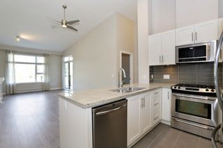 """Photo 6: 305 23285 BILLY BROWN Road in Langley: Fort Langley Condo for sale in """"The Village at Bedford Landing"""" : MLS®# R2211106"""