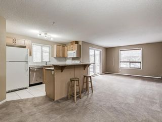Photo 2: 3101 60 PANATELLA Street NW in Calgary: Panorama Hills Apartment for sale : MLS®# A1094404