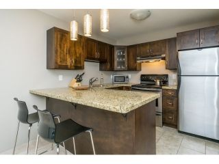 """Photo 2: 215 450 BROMLEY Street in Coquitlam: Coquitlam East Condo for sale in """"BROMLEY MANOR"""" : MLS®# R2030083"""