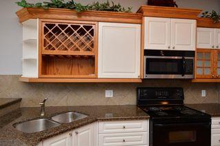 Photo 11: 303 GLENEAGLES View: Cochrane House for sale : MLS®# C4130061