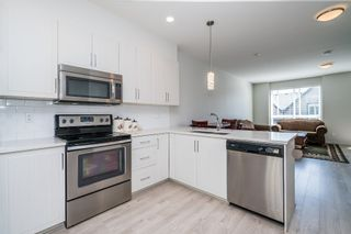 """Photo 12: 100 14555 68 Avenue in Surrey: East Newton Townhouse for sale in """"SYNC"""" : MLS®# R2169561"""