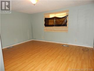 Photo 11: 10208 & 10210 98 Avenue in High Level: House for sale : MLS®# A1087602