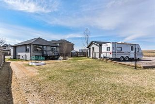 Photo 25: 75 Crystal Shores Crescent: Okotoks Detached for sale : MLS®# A1096925