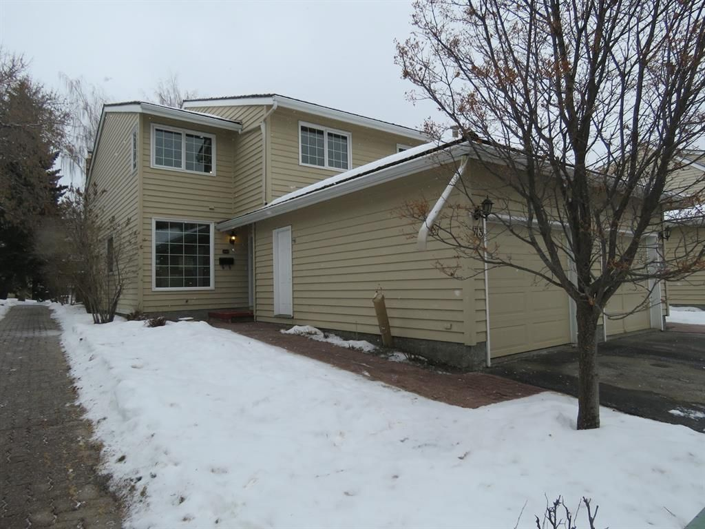Main Photo: 373 Point Mckay Gardens NW in Calgary: Point McKay Row/Townhouse for sale : MLS®# A1063969
