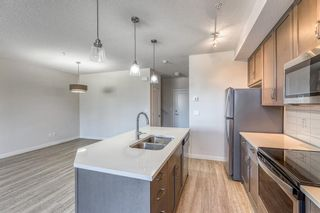 Photo 4: 12 30 Shawnee Common SW in Calgary: Shawnee Slopes Apartment for sale : MLS®# A1106401
