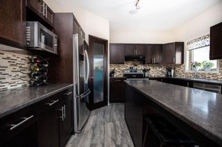 Photo 11: 16 Caribou Crescent in Winnipeg: South Pointe Residential for sale (1R)  : MLS®# 202109549