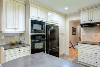 """Photo 8: 26518 100 Avenue in Maple Ridge: Thornhill House for sale in """"THORNHILL URBAN RESERVE"""" : MLS®# R2063894"""