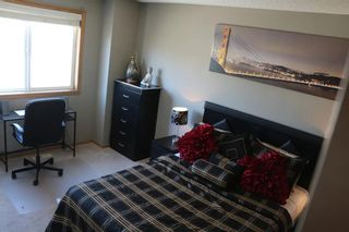Photo 15: 219 Rocky Vista Circle NW in Calgary: Rocky Ridge Row/Townhouse for sale : MLS®# A1074376