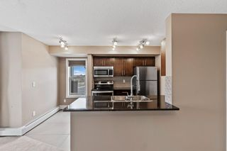 Photo 7: 7411 403 Mackenzie Way SW: Airdrie Apartment for sale : MLS®# A1152134