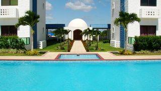 Photo 1: Playa Blanca Resort mid floor ocean view 199K