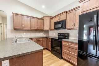 Photo 6: 305 Sunvale Crescent NE: High River Row/Townhouse for sale : MLS®# A1144470