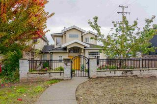 Photo 1: 380 STRATFORD Avenue in Burnaby: Capitol Hill BN 1/2 Duplex for sale (Burnaby North)  : MLS®# R2411548