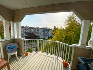 """Photo 1: 313 20897 57 Avenue in Langley: Langley City Condo for sale in """"Arbour Lane"""" : MLS®# R2623448"""