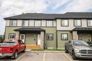 Photo 1: 102 140 Sagewood Boulevard SW: Airdrie Row/Townhouse for sale : MLS®# A1141135