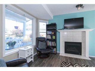 Photo 6: 8 SUN RIDGE Close NW: Airdrie House for sale : MLS®# C4048800