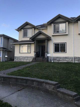 Photo 2: 827 ALDERSON Avenue in Coquitlam: Coquitlam West 1/2 Duplex for sale : MLS®# R2507536