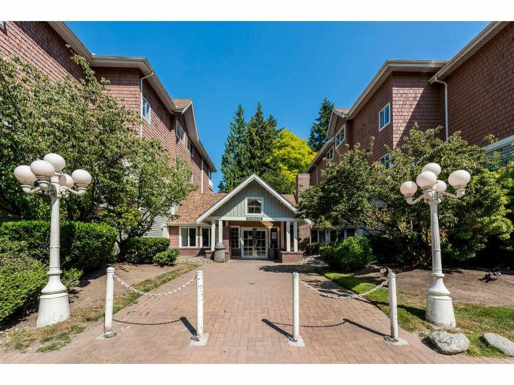 """Photo 1: Photos: 201 9626 148TH Street in Surrey: Guildford Condo for sale in """"Hartfood Woods"""" (North Surrey)  : MLS®# R2329881"""