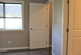 Photo 31: 1404 Clover Link: Carstairs Row/Townhouse for sale : MLS®# A1073804