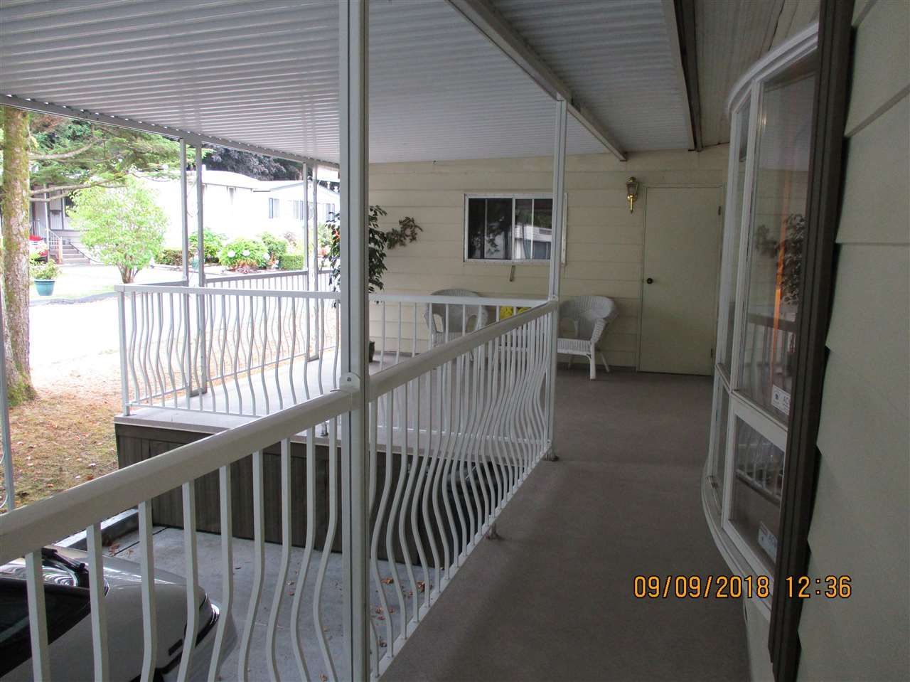 """Photo 2: Photos: 104 7850 KING GEORGE Boulevard in Surrey: East Newton Manufactured Home for sale in """"BEAR CREEK GLEN"""" : MLS®# R2306546"""