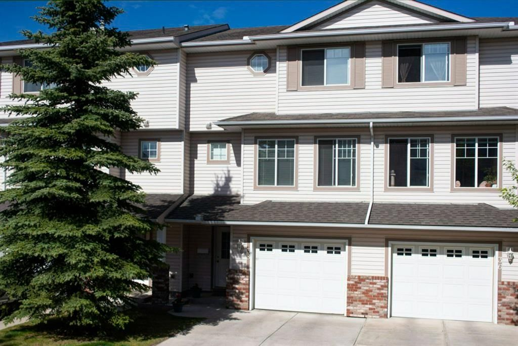 Main Photo: 38 Country Hills Cove NW in Calgary: Country Hills Row/Townhouse for sale : MLS®# A1116176