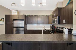 Photo 5: 1204 10 AUBURN BAY Avenue SE in Calgary: Auburn Bay Row/Townhouse for sale : MLS®# A1065411