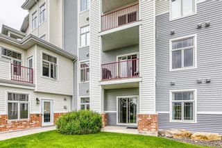 Photo 2: 105 8 Country Village Bay NE in Calgary: Country Hills Village Apartment for sale : MLS®# A1062313