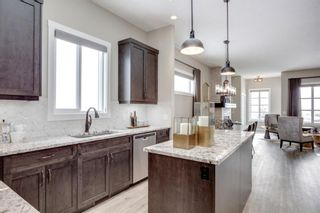 Photo 8: 230 Lucas Parade NW in Calgary: Livingston Detached for sale : MLS®# A1057760