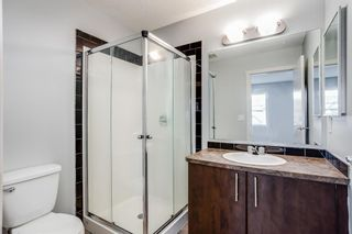 Photo 16: 107 2445 Kingsland Road SE: Airdrie Row/Townhouse for sale : MLS®# A1151788