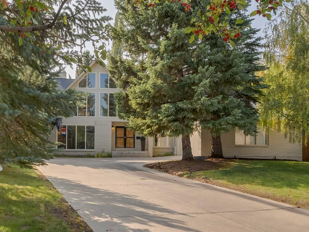 Stunning custom-built 2 storey home on a fabulous quiet tree lined street in sought after neighborhood of Pump Hill.