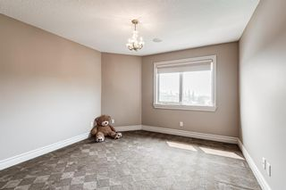 Photo 29: 64 Rockcliff Point NW in Calgary: Rocky Ridge Detached for sale : MLS®# A1125561