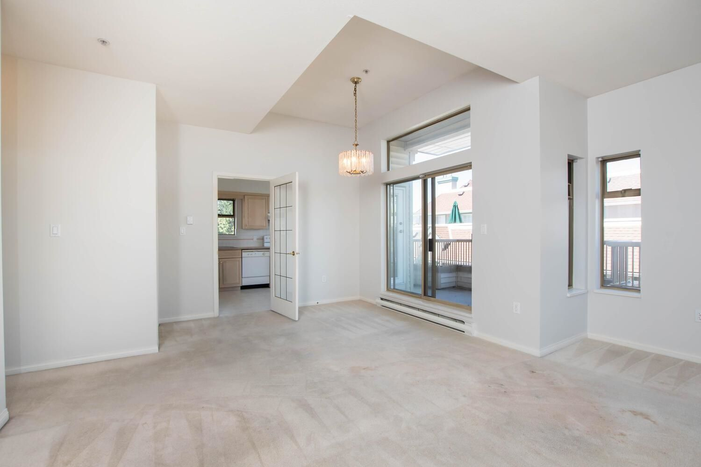 "Main Photo: 301 1118 55 Street in Delta: Tsawwassen Central Condo for sale in ""CAMBRIDGE PLACE"" (Tsawwassen)  : MLS®# R2596618"