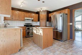 Photo 7: 142 Hawkdale Circle NW in Calgary: Hawkwood Detached for sale : MLS®# A1150961