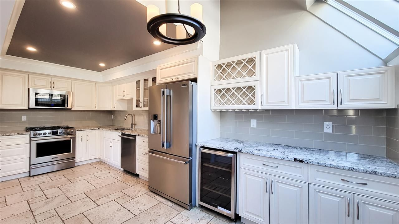 """Main Photo: 8514 WOODTRAIL Place in Burnaby: Forest Hills BN Townhouse for sale in """"SIMON FRASER VILLAGE"""" (Burnaby North)  : MLS®# R2566509"""