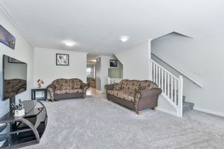 Photo 11: 102 9580 PRINCE CHARLES Boulevard in Surrey: Queen Mary Park Surrey Townhouse for sale : MLS®# R2295935
