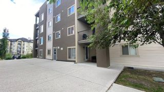 Photo 2: 9104 403 Mackenzie Way SW: Airdrie Apartment for sale : MLS®# A1122241