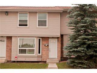 Photo 1: 94 123 QUEENSLAND Drive SE in Calgary: Queensland House for sale : MLS®# C4027673