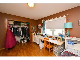 Photo 28: 108 GLENEAGLES Terrace: Cochrane House for sale : MLS®# C4113548