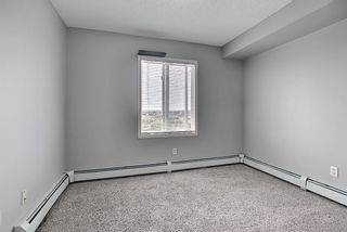 Photo 25: 6413 304 Mackenzie Way SW: Airdrie Apartment for sale : MLS®# A1128019