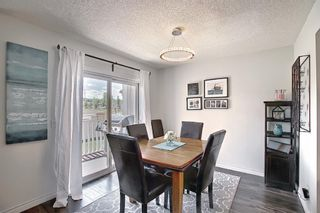 Photo 15: 154 388 Sandarac Drive NW in Calgary: Sandstone Valley Row/Townhouse for sale : MLS®# A1115422