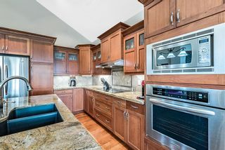 Photo 9: 107 Tuscany Glen Park NW in Calgary: Tuscany Detached for sale : MLS®# A1144960