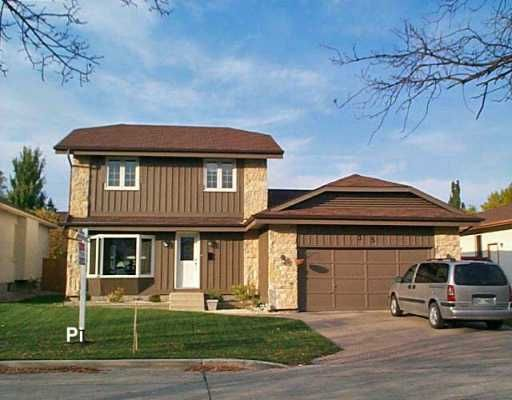 Main Photo: 35 HENNESSEY Drive in Winnipeg: River Heights / Tuxedo / Linden Woods Single Family Detached for sale (South Winnipeg)  : MLS®# 2617381