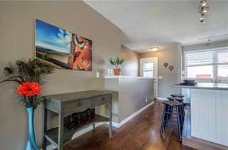 Photo 9: 75 SUMMERWOOD Road SE: Airdrie House for sale : MLS®# C4174518