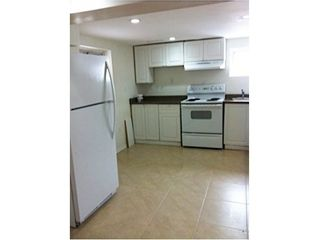 Photo 2: Duplex with 2 basement apartments