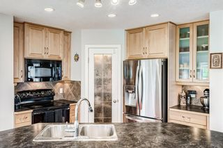 Photo 5: 240 PANORA Close NW in Calgary: Panorama Hills Detached for sale : MLS®# A1114711